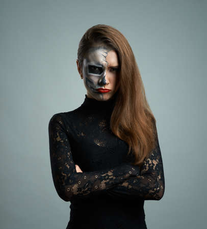 beautiful  pouted woman with make-up skeleton photo