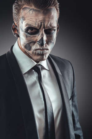 corrects: Portrait serious businessman with makeup skeleton Stock Photo