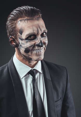 cunning businessman with a make-up of the skeleton photo