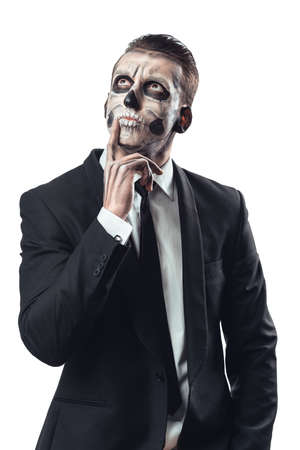 pensive businessman with make-up skeleton photo