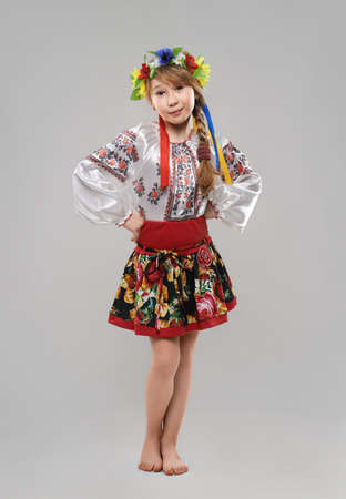 garb: Pretty red-haired girl in the Slavic national costume