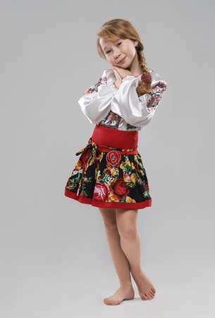 Pretty red-haired girl in the Slavic national costume photo