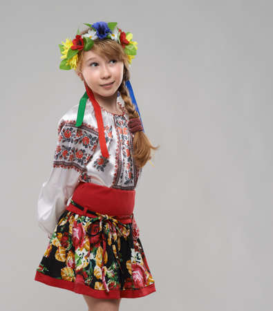 Pretty red-haired girl in the Slavic national costume dreams photo