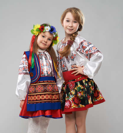 two girls in the Slavic folk costumes photo