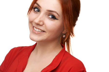 sweetly: Redhead beautiful girl smiles sweetly