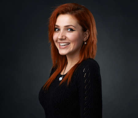 headshoot: beautiful red-haired girl having fun smiling