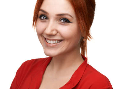 headshoot: Redhead beautiful girl smiles sweetly