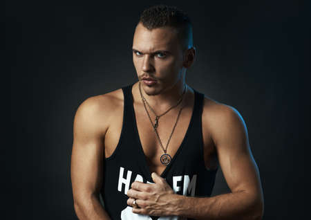 suntanned: sexy sporty man on black background Stock Photo