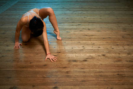girl crawling on the floor in the ballroom