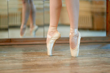 beautiful legs of a dancer in pointe photo