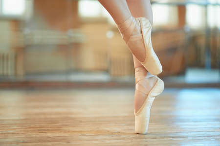 stockings feet: beautiful legs of a dancer in pointe Stock Photo