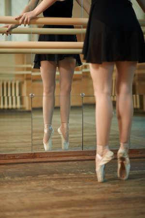 barre: slender legs woman  dancers near Barre