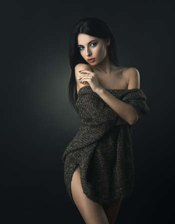 tempt: sexy brunette wrapped in warm sweater