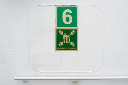 muster: information plate of assembly station on the wall Stock Photo