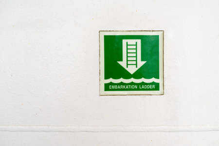 information plate of embarkation ladder on  wall photo