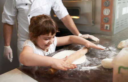 roll out: little girl learns to roll out the dough