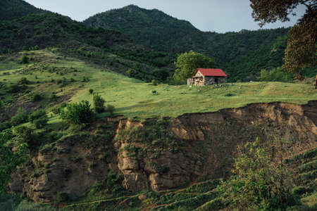 red mountain: beautiful small house with red roof near the mountain