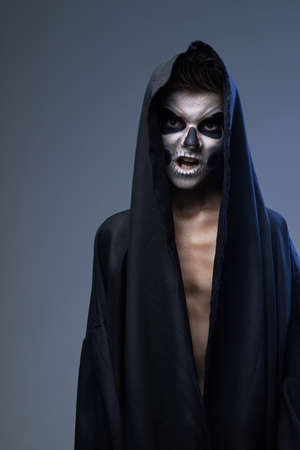guise: angry teenager with makeup skull cape