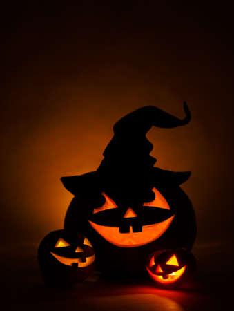 jack'o'lantern: Three jack-o-Lantern at dark background