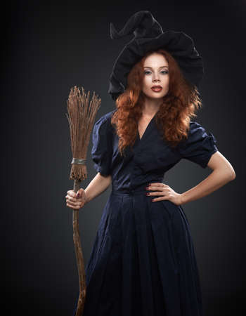 enchantress: beautiful red-haired girl in a blue costume witch Stock Photo