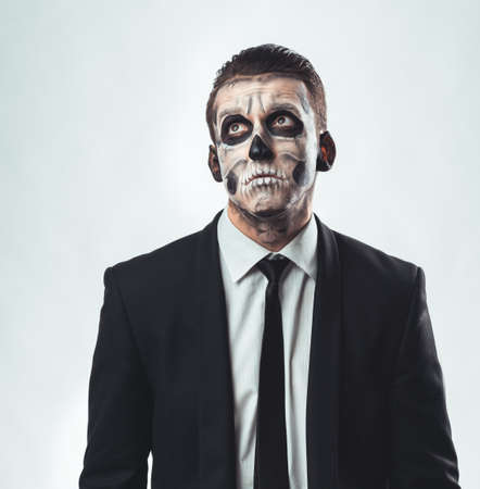 sad businessman: Sad businessman with make-up skeleton