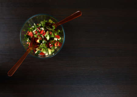 beautiful salad: beautiful salad on the black wood background Stock Photo
