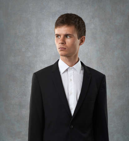 dissatisfaction: angry man is looking furiously and dissatisfaction Stock Photo