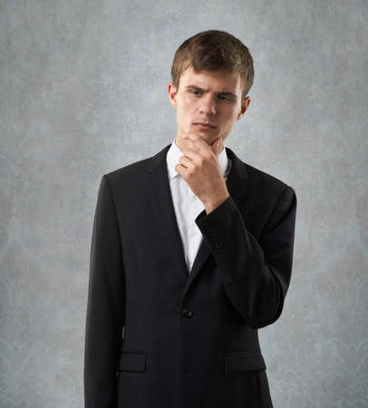 ponder: staying man is ponder  an issue Stock Photo
