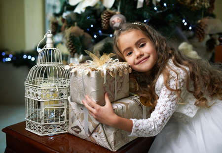 rejoices: Cute  girl rejoices Gifts for Christmas Stock Photo