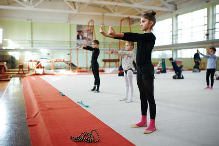ballerina costume: children do in class warm-up calisthenics