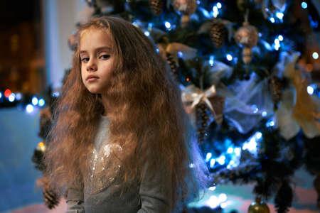 she: she despises the little girl near the Christmas tree