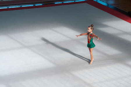 stretchy: The gymnast is in the initial position, hands to the side