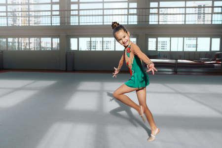 stretchy: cheerful girl gymnast performs a dance in rhythmic gymnastics Stock Photo
