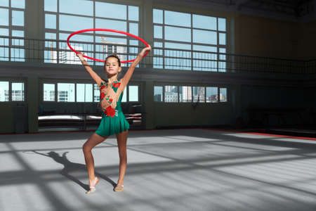 stretchy: beautiful gymnast holds the hoop overhead Stock Photo