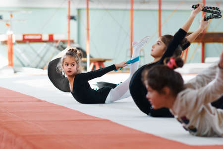 suppleness: girl repeats of another exercise gymnastics