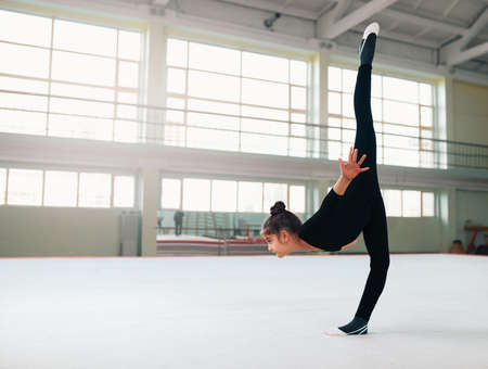 stretchy: The gymnast performs a balance with split. Stock Photo