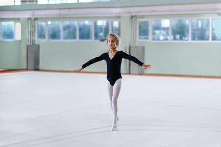beautiful girl training rhythmic gymnastics
