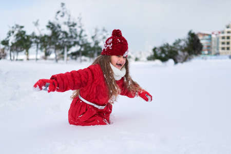 she: she sneaks through the thick snow blockage
