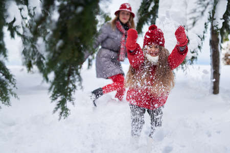 girl provokes play with snow