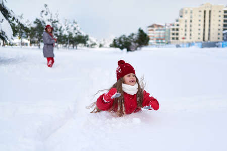 snow falls: Funny girl playing in the snow falls