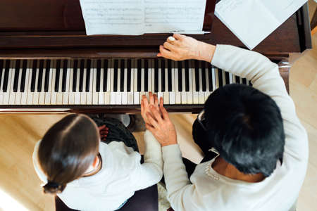 piano lesson at a music school, top view 写真素材