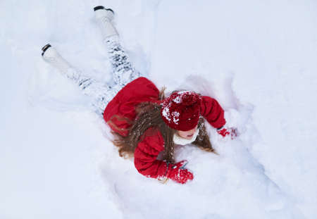 she: she fell in the snow and lay Stock Photo