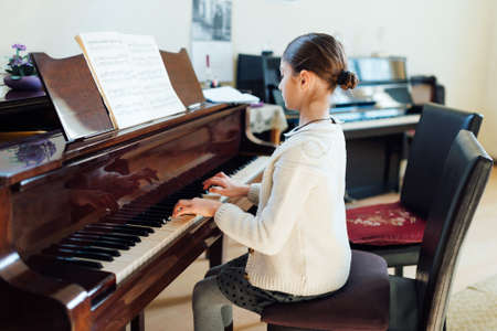 grand kid: good student plays the piano at a music school