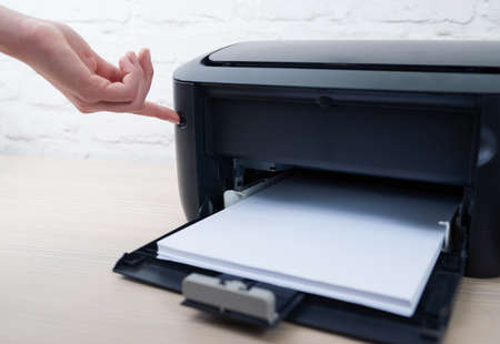 enable: press the button to enable or disable the printer Stock Photo