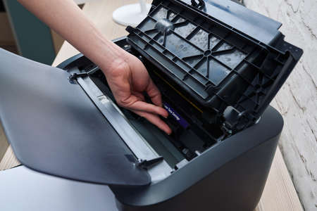 replace: extract cartridge of a laser printer to replace