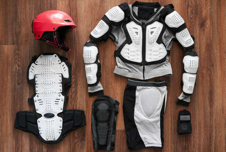 protective clothing: protective clothing and a helmet for the sport on a wooden floor