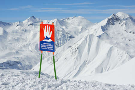 avalanche: warning signs of avalanche on the slopes of the mountain in winter