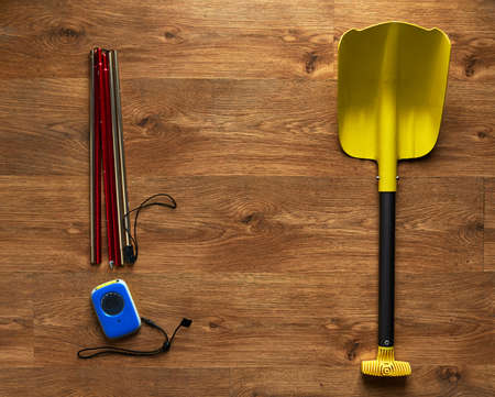 salvaging: avalanche rescue kit, lying on the wooden floor.