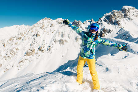 woman is dancing in the yellow trousers in the mountain Stock Photo