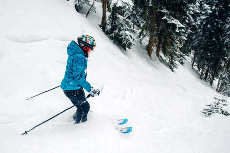 girl with special ski equipment is riding fast jumping freeriding